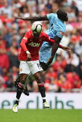 LONDON, ENGLAND - AUGUST 07:  Micah Richards of Manchester City jumps with Ashley Young of Manchester United during the FA Community Shield match sponsored by McDonald's between Manchester City and Manchester United at Wembley Stadium on August 7, 2011 in
