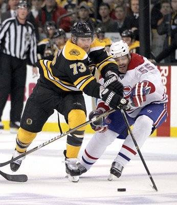 BOSTON, MA - APRIL 27:  Michael Ryder #73 of the Boston Bruins battles Brent Sopel #55 of the Montreal Canadiens in Game Seven of the Eastern Conference Quarterfinals during the 2011 NHL Stanley Cup Playoffs at TD Garden on April 27, 2011 in Boston, Massa