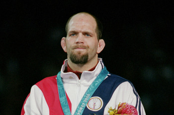SYDNEY - SEPTEMBER 26:  Matt James Lindland of the USA receives a Bronze medal in the Men's Greco Roman Wrestling during the Sydney 2000 Olympic Games on September 26,2000 at the Exhibition Hall in Sydney, Austraila. (Photo by Al Bello/Getty Images)