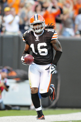 CLEVELAND, OH - AUGUST 13: Wide receiver Josh Cribbs #16 runs to celebrate in the Dog Pound after catching a pass from starting quarterback Colt McCoy #12 (not shown) of the Cleveland Browns for a touchdown during the first quarter at Cleveland Browns Sta