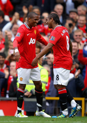 MANCHESTER, ENGLAND - AUGUST 28:  Ashley Young of Manchester United celebrates scoring his side's second goal with team mate Anderson (R) during the Barclays Premier League match between Manchester United and Arsenal at Old Trafford on August 28, 2011 in
