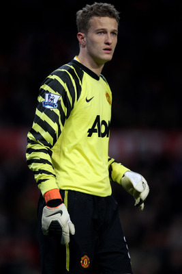MANCHESTER, ENGLAND - FEBRUARY 19:  Goalkeeper Anders Lindegaard of Manchester United looks on during the FA Cup sponsored by E.ON 5th round match between Manchester United and Crawley Town at Old Trafford on February 19, 2011 in Manchester, England.  (Ph