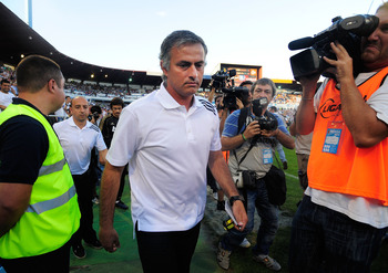 ZARAGOZA, SPAIN - AUGUST 28:  Real Madrid head coach, Jose Mourinho takes to the field before the La Liga match between Real Zaragoza and Real Madrid at estadio La Romareda on August 28, 2011 in Zaragoza, Spain.  (Photo by Denis Doyle/Getty Images)