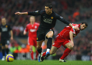 LIVERPOOL, UNITED KINGDOM - DECEMBER 16:  Cristiano Ronaldo of Manchester United holds off the challenge of Javier Mascherano of Liverpool during the Barclays Premier League match between Liverpool and Manchester United at Anfield on December 16, 2007 in