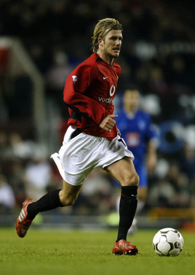MANCHESTER - DECEMBER 28:  David Beckham of Manchester United running with the ball during the FA Barclaycard Premiership match between Manchester United and Birmingham City held on December 28, 2002 at Old Trafford in Manchester, England.  Manchester Uni