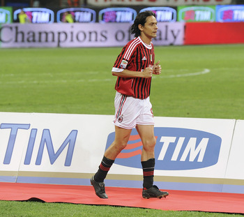MILAN, ITALY - MAY 14:  Filippo Inzaghi of Milan collects his medal during the awarding ceremony of the Italian Serie A championship after the Serie A match between AC Milan and Cagliari Calcio at Stadio Giuseppe Meazza on May 14, 2011 in Milan, Italy.  (