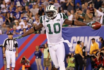 EAST RUTHERFORD, NJ - AUGUST 29:  Santonio Holmes #10 of the New York Jets celebrates his second quarter touchdown reception against the New York Giants during their pre season game on August 29, 2011 at MetLife Stadium in East Rutherford, New Jersey.  (P