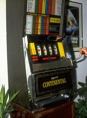 Sep 1989:  Osella Ford driver Nicola Larini of Italy plays on a slot machine at his home in Italy. \ Mandatory Credit: Pascal  Rondeau/Allsport