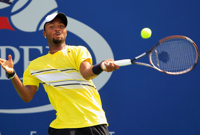 NEW YORK, NY - SEPTEMBER 02:  Donald Young of the United States returns a shot against Stanislas Wawrinka of Switzerland during Day Five of the 2011 US Open at the USTA Billie Jean King National Tennis Center on September 2, 2011 in the Flushing neighborh