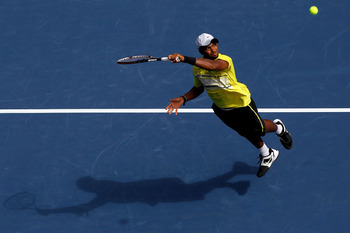 NEW YORK, NY - SEPTEMBER 08:  Donald Young of the United States returns a shot against Andy Murray of Great Britain returns a shot against during Day Eleven of the 2011 US Open at the USTA Billie Jean King National Tennis Center on September 8, 2011 in th
