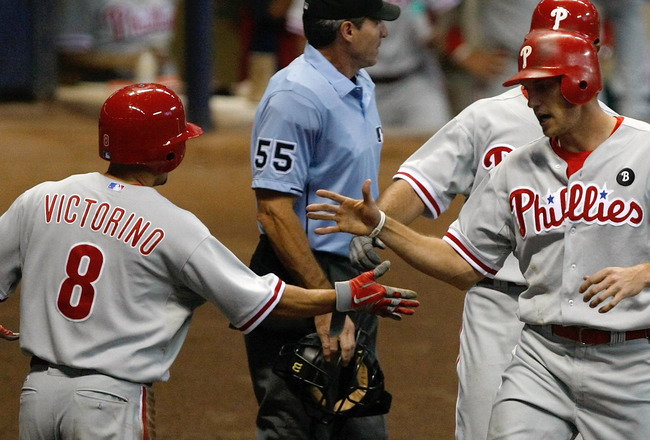MILWAUKEE, WI - SEPTEMBER 9: Hunter Pence #3 of the Philadelphia Phillies is congratulated by Shane Victorino #8 after scoring a run during the game against the Milwaukee Brewers at Miller Park on September 9, 2011 in Milwaukee, Wisconsin. The Phillies de