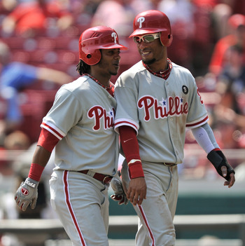 CINCINNATI, OH - SEPTEMBER 1:  Michael Martinez #19 of the Philadelphia Phillies and Wilson Valdez #21 of the Philadelphia Phillies celebrate Martinez's two-run home run against the Cincinnati Reds at Great American Ball Park on September 1, 2011 in Cinci