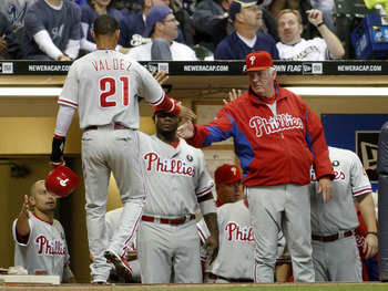 MILWAUKEE, WI - SEPTEMBER 8:  The  Philadelphia Phillies celebrate two runs scored on a hit by Hunter Pence against the Milwaukee Brewers at Miller Park on September 8, 2011 in Milwaukee, Wisconsin. (Photo by Mark Hirsch/Getty Images)