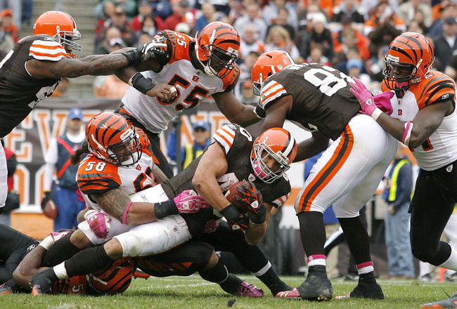 CLEVELAND - OCTOBER 03:  Running back Peyton Hillis #40 of the Cleveland Browns is tackled by defenders Keith Rivers #55 and Rey Maualuga #58 of the Cincinnati Bengals at Cleveland Browns Stadium on October 3, 2010 in Cleveland, Ohio.  (Photo by Matt Sull