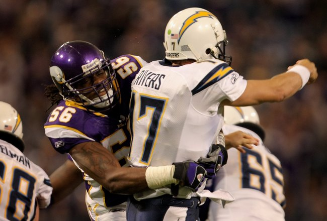 MINNEAPOLIS, MN - NOVEMBER 04:  Linebacker E.J. Henderson #58 of the Minnesota Vikings hits quarterback Philip Rivers #17 the San Diego Chargers as he delivers a pass at the Hubert H. Humphrey Metrodome on November 4, 2007 in Minneapolis, Minnesota. The V