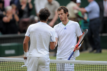 LONDON, ENGLAND - JULY 01:  Rafael Nadal of Spain (L) shakes hands with Andy Murray of Great Britain  after winning his semifinal round match on Day Eleven of the Wimbledon Lawn Tennis Championships at the All England Lawn Tennis and Croquet Club on July