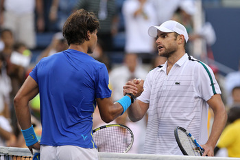 NEW YORK, NY - SEPTEMBER 09:  Rafael Nadal (L) of Spain shakes hands with Andy Roddick (R) of the United States after their match during Day Twelve of the 2011 US Open at the USTA Billie Jean King National Tennis Center on September 9, 2011 in the Flushin