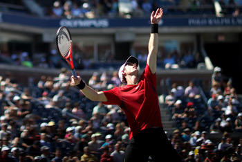 NEW YORK, NY - SEPTEMBER 09:  Andy Murray of Great Britain serves against John Isner of the United States during Day Twelve of the 2011 US Open at the USTA Billie Jean King National Tennis Center on September 9, 2011 in the Flushing neighborhood of the Qu