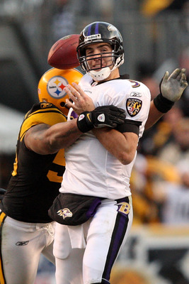 PITTSBURGH - DECEMBER 27:  LaMarr Woodley #56 of the Pittsburgh Steelers forces Joe Flacco #5 of the Baltimore Ravens to fumble during the game at Heinz Field on December 27, 2009 in Pittsburgh, Pennsylvania.  Pittsburgh won the game, 23-20. (Photo by Kar