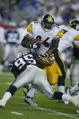 FOXBORO, MA - SEPTEMBER 9:  Roman Phifer #95 of the New England Patriots stops Jerome Bettis #36 of the Pittsburgh Steelers during the game on September 9, 2002 at Gillette Stadium in Foxboro, Massachusetts.  The Patriots defeated the Steelers 30-14.  (Ph