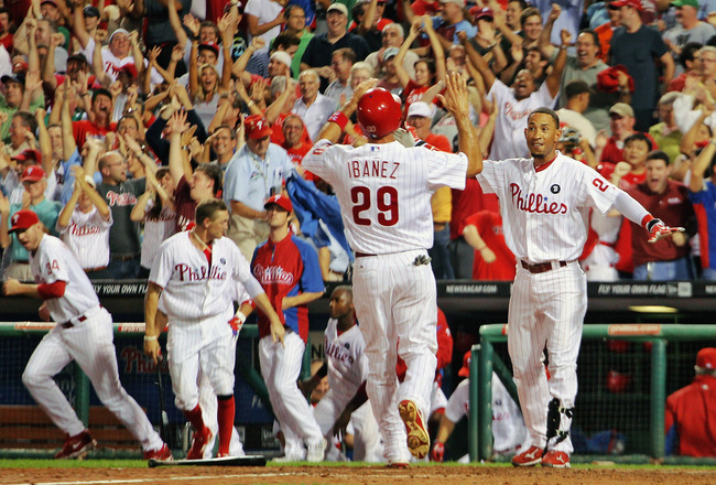 PHILADELPHIA , PA - SEPTEMBER 07:  Raul Ibanez #29 of the Philadelphia Phillies scores the Phillies winning run on Ross Gload's walk off winning hit against the Atlanta Braves at Citizens Bank Park on September 7, 2011 in Philadelphia, Pennsylvania.  (Pho