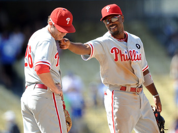 LOS ANGELES, CA - AUGUST 10:  Jimmy Rollins #11 of the Philadelphia Phillies and Chase Utley #26 joke after a 9-7 win over the Los Angeles Dodgers at Dodger Stadium on August 10, 2011 in Los Angeles, California.  (Photo by Harry How/Getty Images)