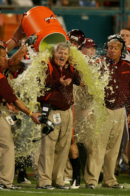 MIAMI - JANUARY 01:  Head coach Frank Beamer of the Virginia Tech Hokies gets gatorade dump on him by his players on their way to winning against the Cincinnati Bearcats during the FedEx Orange Bowl at Dolphin Stadium on January 1, 2009 in Miami, Florida.