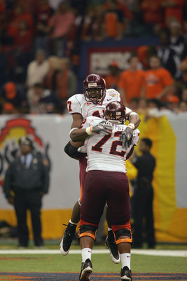 NEW ORLEANS - JANUARY 3:  Wide receiver Josh Morgan #17 and guard Jason Murphy #72 of the Virginia Tech Hokies celebrate while facing the Auburn Tigers during the Nokia Sugar Bowl on January 3, 2005 at the Superdome in New Orleans, Louisiana.  The No. 3 T