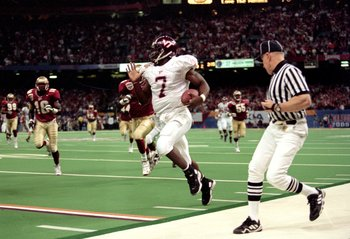 5 Jan 2000:  Michael Vick #7 of the Virginia Tech Hokies runs with the ball during the Nokita Sugar Bowl Game against the Florida State Seminoles at the Louisiana Superdome in New Orleans, Louisiana. The Seminoles defeated the Hokies 46-29. Mandatory Cred