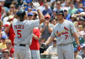 CHICAGO - MAY 30:  Albert Pujols #5 of the St. Louis Cardinals celebrates his first inning home run against the Chicago Cubs with teammate Matt Holliday #7 on May 30, 2010 at Wrigley Field in Chicago, Illinois.  (Photo by Jim McIsaac/Getty Images)