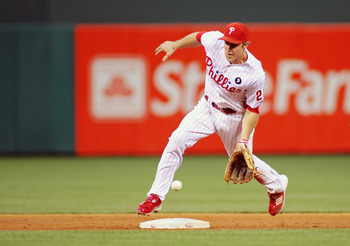PHILADELPHIA , PA - AUGUST 17:  Chase Utley #26 of the Philadelphia Phillies fields the ball against the Arizona Diamondbacks at Citizens Bank Park on August 17, 2011 in Philadelphia, Pennsylvania.  The Phillies defeated the Diamondbacks 9-2. (Photo by Le