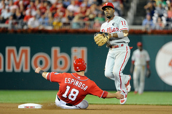 WASHINGTON, DC - AUGUST 20:  Jimmy Rollins #11 of the Philadelphia Phillies forces out Danny Espinosa #18 of the Washington Nationals to start a double play at Nationals Park on August 20, 2011 in Washington, DC.  (Photo by Greg Fiume/Getty Images)