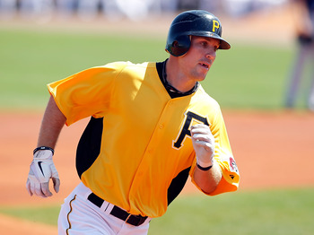 BRADENTON, FL - MARCH 13:  Outfielder John Bowker #14 of the Pittsburgh Pirates rounds the bases after his home run against the Boston Red Sox during a Grapefruit League Spring Training Game at McKechnie Field on March 13, 2011 in Bradenton, Florida.  (Ph