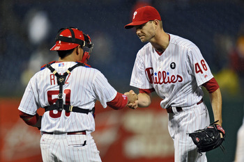 PHILADELPHIA, PA - SEPTEMBER 07: Carlos Ruiz #51 and Ryan Madson #46 of the Philadelphia Phillies shake hands after a 6-3 win over the Atlanta Braves at Citizens Bank Park on September 7, 2011 in Philadelphia, Pennsylvania. (Photo by Drew Hallowell/Getty