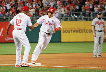PHILADELPHIA , PA - SEPTEMBER 07:  Raul Ibanez #29 of the Philadelphia Phillies celebrates hits second inning homerun with coach Juan Samuel #12 against the Atlanta Braves at Citizens Bank Park on September 7, 2011 in Philadelphia, Pennsylvania.  (Photo b