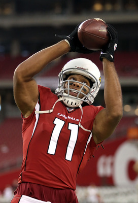 GLENDALE, AZ - SEPTEMBER 01:  Wide receiver Larry Fitzgerald #11 of the Arizona Cardinals warms up before the preseason NFL game against the Denver Broncos at the University of Phoenix Stadium on September 1, 2011 in Glendale, Arizona.  (Photo by Christia