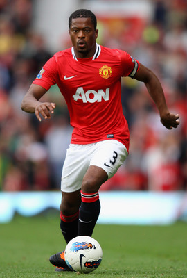 MANCHESTER, ENGLAND - AUGUST 28:  Patrice Evra of Manchester United with the ball during the Barclays Premier League match between Manchester United and Arsenal at Old Trafford on August 28, 2011 in Manchester, England.  (Photo by Alex Livesey/Getty Image