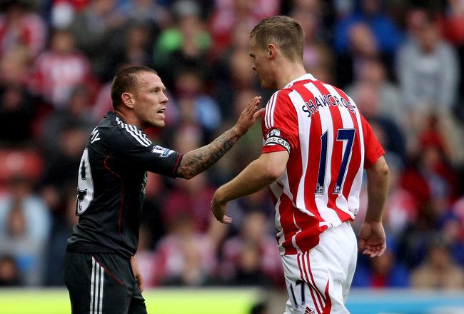 STOKE ON TRENT, ENGLAND - SEPTEMBER 10:  Craig Bellamy of Liverpool comes to blows with Ryan Shawcross of Stoke during the Barclays Premier League match between Stoke City and Liverpool at Britannia Stadium on September 10, 2011 in Stoke on Trent, England