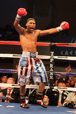 ATLANTIC CITY, NJ - MARCH 26: Yuriorkis Gamboa celebrates after winning the IBF WBA World Featherweight title by beating Jorge Solis of Mexico during Top Rank's 'Featherweight Fury' on March 26, 2011 at Boardwalk Hall in Atlantic City, New Jersey. (Photo