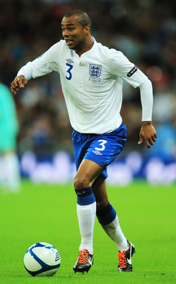 LONDON, ENGLAND - SEPTEMBER 06:  Ashley Cole of England runs with the ball during the UEFA EURO 2012 group G qualifying match between England and Wales at Wembley Stadium  on September 6, 2011 in London, England.  (Photo by David Cannon/Getty Images)