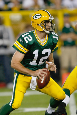 GREEN BAY, WI - SEPTEMBER 8: Aaron Rogers #12 of the Green Bay Packers runs with the football during the game against the New Orleans Saints at Lambeau Field on September 8, 2011 in Green Bay, Wisconsin. The Saints defeated the Packers 42-34. (Photo by Sc