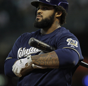 HOUSTON, TX - SEPTEMBER 3: Prince Fielder #28 of the Milwaukee Brewers removes his batting gloves after striking out in the fourth inning against the Houston Astros on September 3,  2011 at Minute Maid Park in Houston, Texas. (Photo by Thomas B. Shea/Gett