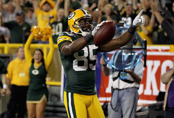 GREEN BAY, WI - SEPTEMBER 08:  Greg Jennings #85 of the Green Bay Packers celebrates after scoring a touchdown in the first quarter against the New Orleans Saints during the season opening game at Lambeau Field on September 8, 2011 in Green Bay, Wisconsin