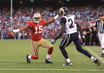 SAN FRANCISCO - NOVEMBER 14:  Michael Crabtree #15 of the San Francisco 49ers celebrates after scoring a touchdown while defended by Ron Bartell #24 of the St. Louis Rams at Candlestick Park on November 14, 2010 in San Francisco, California.  (Photo by Ez