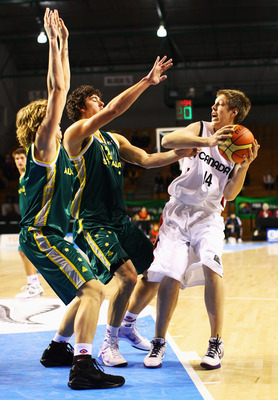AUCKLAND, NEW ZEALAND - JULY 02:  Kelly Olynyk of Canada is blocked by the Australia defence during the FIBA Under 19 World Championship match between Australia and Canada at the North Shore Events Centre on July 2, 2009 in Auckland, New Zealand.  (Photo