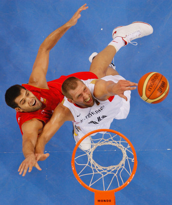 BEIJING - AUGUST 14:  Felipe Reyes #9 of Spain and Dirk Nowitzki #14 of Germany battle for the ball during the Men's Preliminary Round Group B basketball game at the Olympic Basketball Gymnasium during day 6 of the Beijing 2008 Olympic Games on August 14,