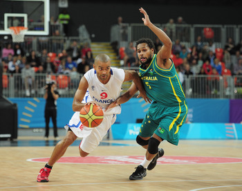 LONDON, ENGLAND - AUGUST 17:  Tony Parker of France is challenged by Patty Mills of Australia during the London Prepares Series match between France and Australia at the Basketball Arena on August 17, 2011 in London, England.  (Photo by Shaun Botterill/Ge