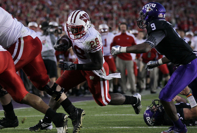 PASADENA, CA - JANUARY 01:  Running back Montee Ball #28 of the Wisconsin Badgers rushes with the ball against the TCU Horned Frogs during the 97th Rose Bowl game on January 1, 2011 in Pasadena, California.  (Photo by Stephen Dunn/Getty Images)