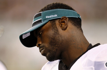 EAST RUTHERFORD, NJ - SEPTEMBER 01:   Michael Vick #7 of the Philadelphia Eagles stands on the sidelines during a pre-season game against the New York Jets at MetLife Stadium on September 1, 2011 in East Rutherford, New Jersey.  (Photo by Jeff Zelevansky/