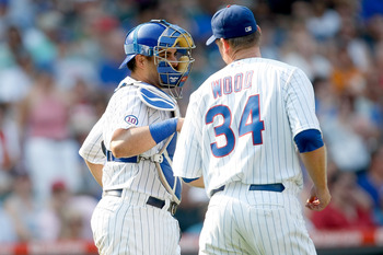 CHICAGO, IL - SEPTEMBER 2: Geovany Soto #18 of the Chicago Cubs talks with Kerry Wood #34 during the game against the Pittsburgh Pirates at Wrigley Field on September 2, 2011. The Pirates defeated the Cubs 3-1.(Photo by Scott Boehm/Getty Images)